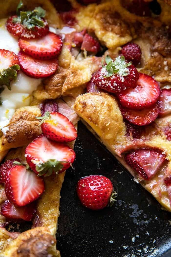 overhead close up photo of Lemon Strawberry Dutch Baby with Ricotta Cream