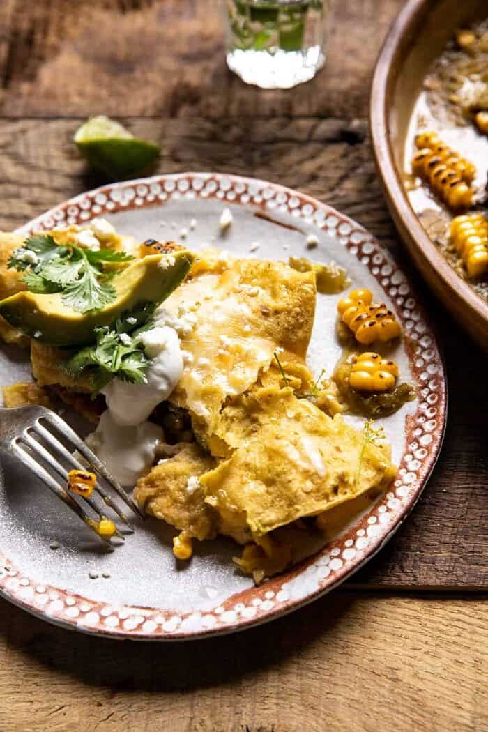 Sheet Pan Chipotle Cheddar Corn Chicken Enchiladas on dinner plate