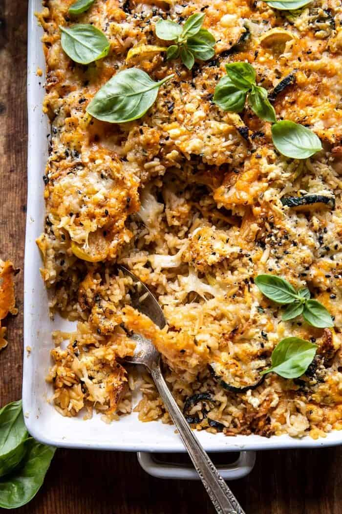 overhead close up photo of Cheesy Zucchini Chicken and Rice Bake