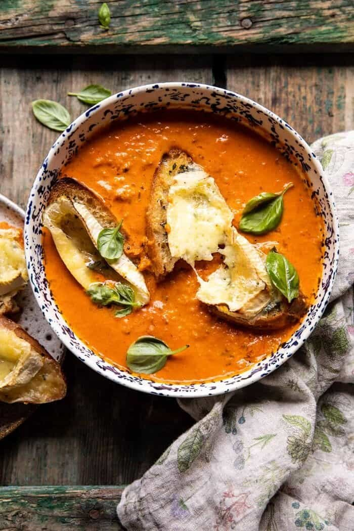 overhead photo of Easiest Herby Tomato Soup with Melted Brie Crostini