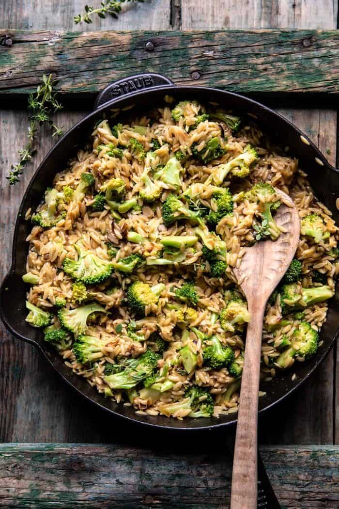 process photo of Cheesy Broccoli Cheddar Orzo in skillet before adding cheese and before baking