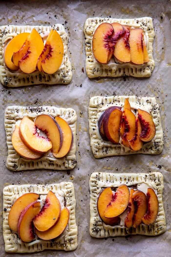 overhead photo of Peach Brie Pastry Tarts on baking sheet before baking