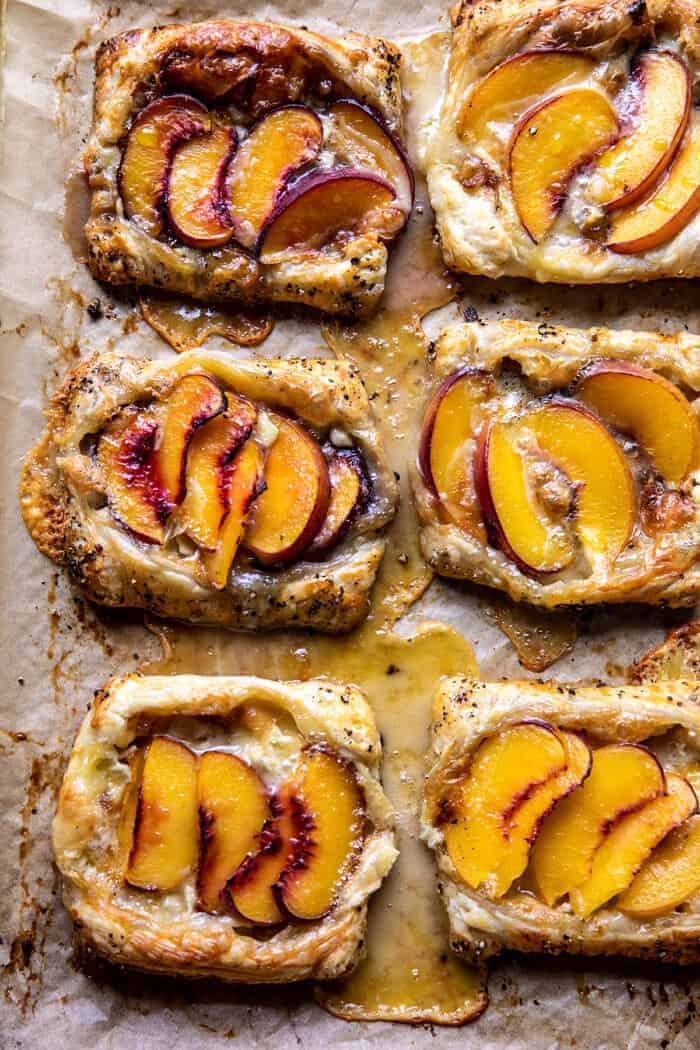 overhead photo of Peach Brie Pastry Tarts on baking sheet after baking