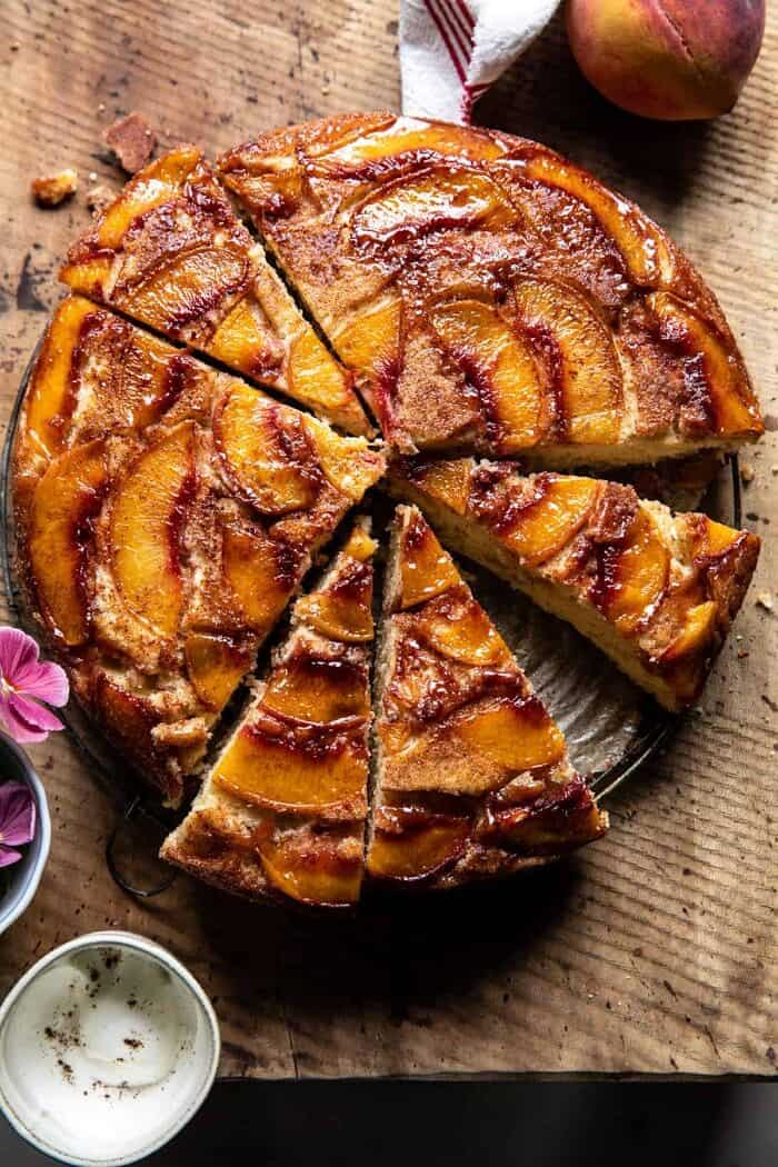 overhead photo of Skillet Cinnamon Sugar Peach Upside Down Cake with slices of cake cut