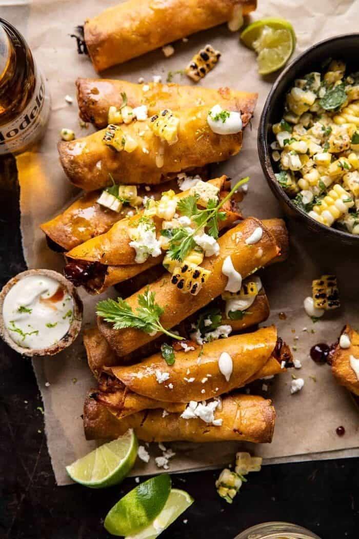 overhead photo of Crockpot BBQ Beer Chicken Taquitos with Street Corn Salsa