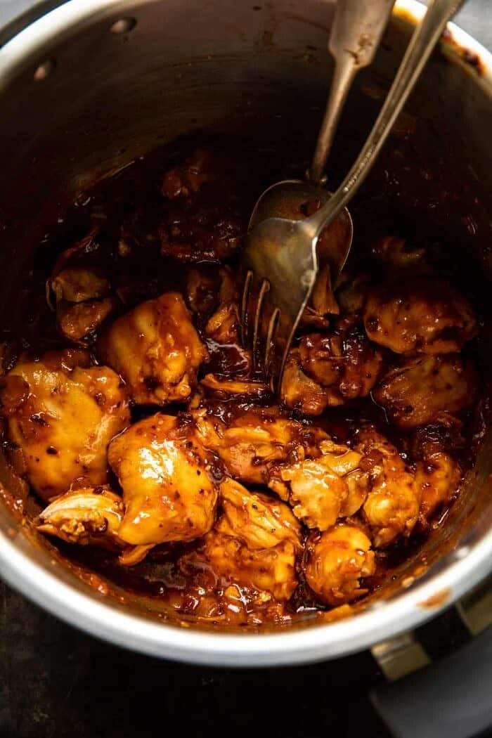 overhead photo of Crockpot BBQ Beer Chicken in crockpot bowl