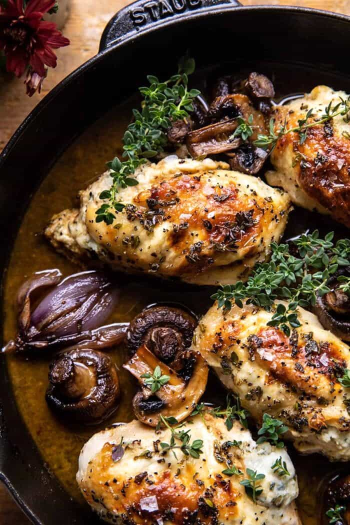 overhead close up photo of Herbed Ricotta Stuffed Chicken In White Wine Pan Sauce
