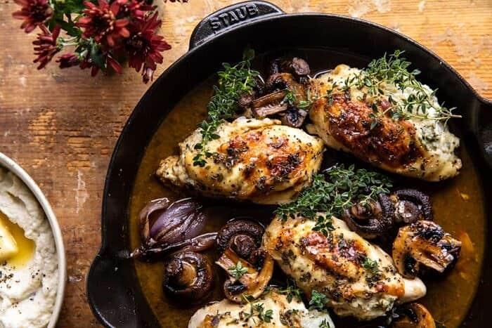 overhead horizontal photo of Herbed Ricotta Stuffed Chicken In White Wine Pan Sauce