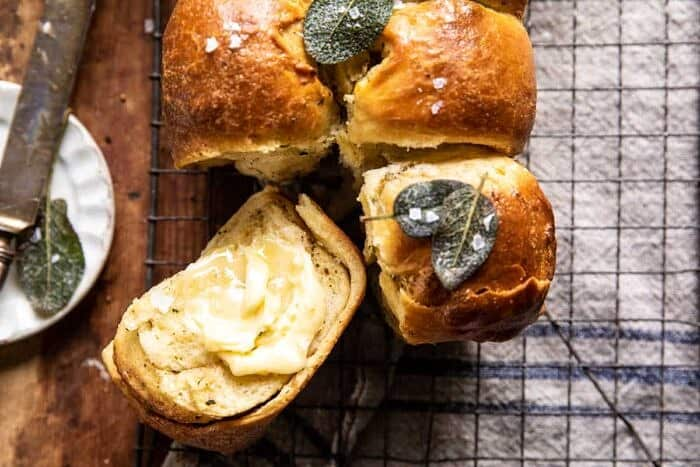 overhead horizontal photo of Pull Apart Parmesan Sage Butter Brioche Rolls