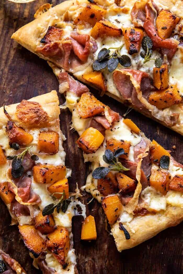 overhead close up photo of Roasted Butternut Squash Prosciutto Pizza with Caramelized Onions