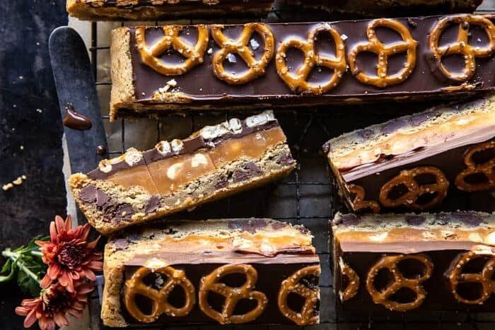 overhead horizontal photo of Salted Pretzel Chocolate Chip Cookie Snickers Bars