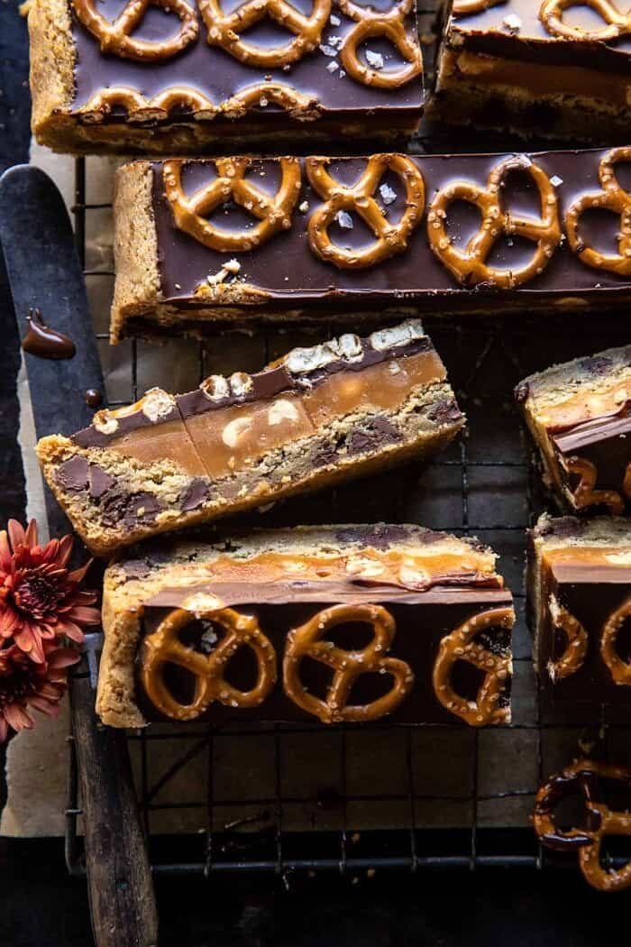 overhead close up photo of Salted Pretzel Chocolate Chip Cookie Snickers Bars