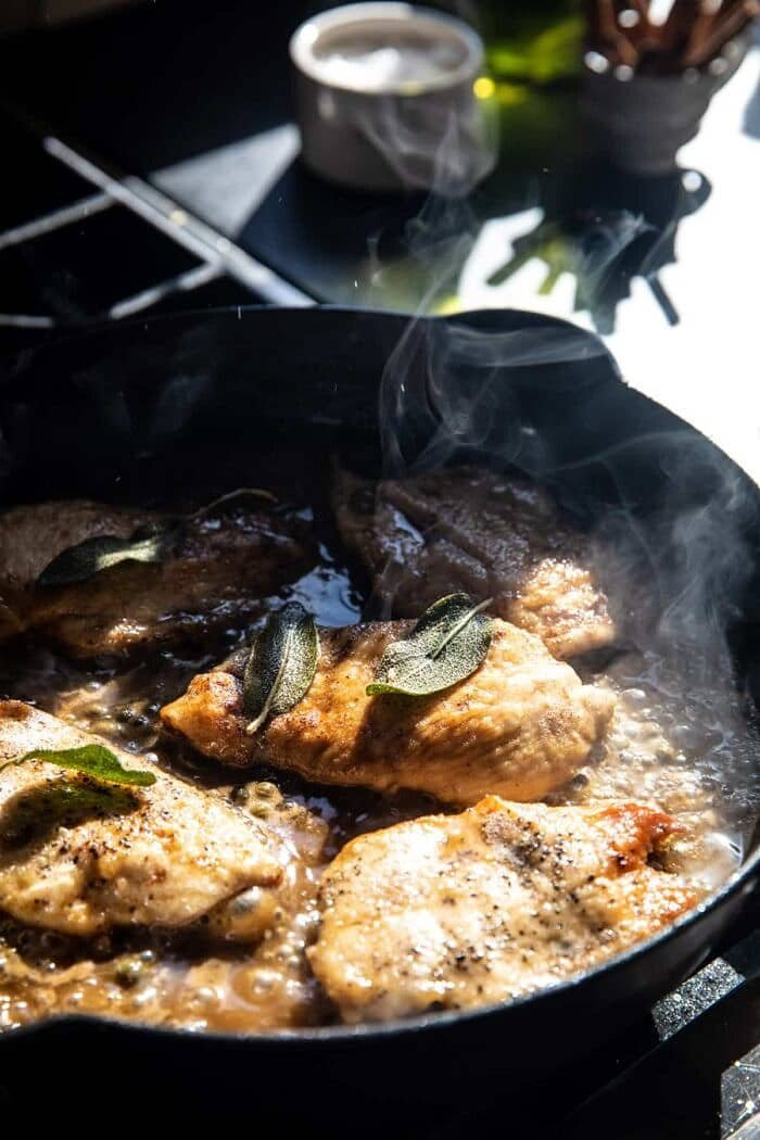 photo of Browned Sage Butter Chicken Piccata cooking on the stove in skillet