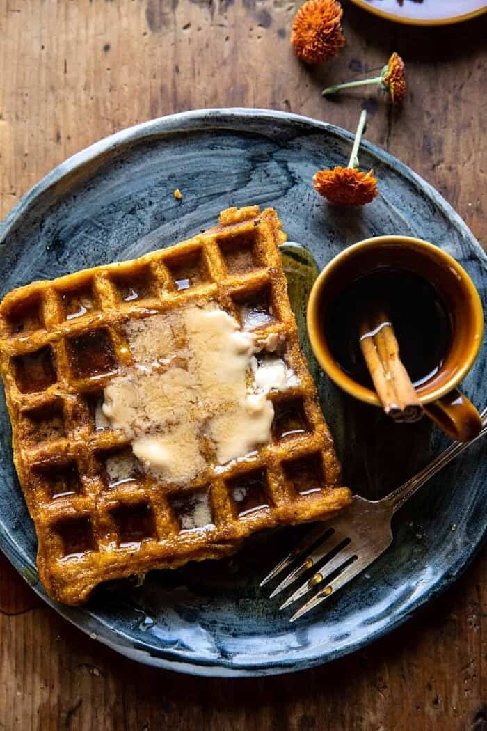 overhead photo of Cider Pumpkin Waffles with Salted Maple Butter