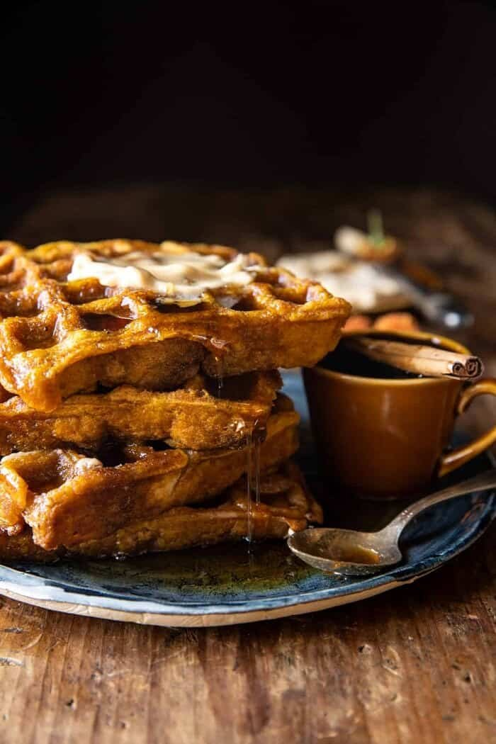 side angled photo of Cider Pumpkin Waffles with Salted Maple Butter