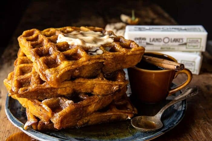 side angle horizontal photo of Cider Pumpkin Waffles with Salted Maple Butter