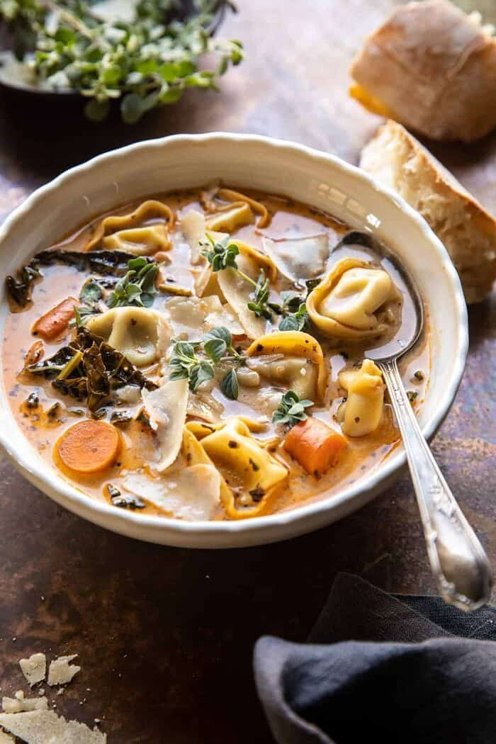 side angled photo of Healthier Slow Cooker Creamy Tortellini Vegetable Soup
