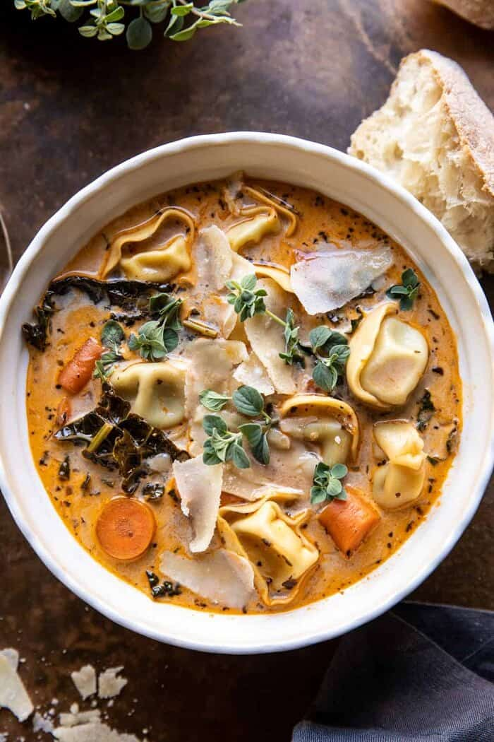 overhead close up photo of Healthier Slow Cooker Creamy Tortellini Vegetable Soup