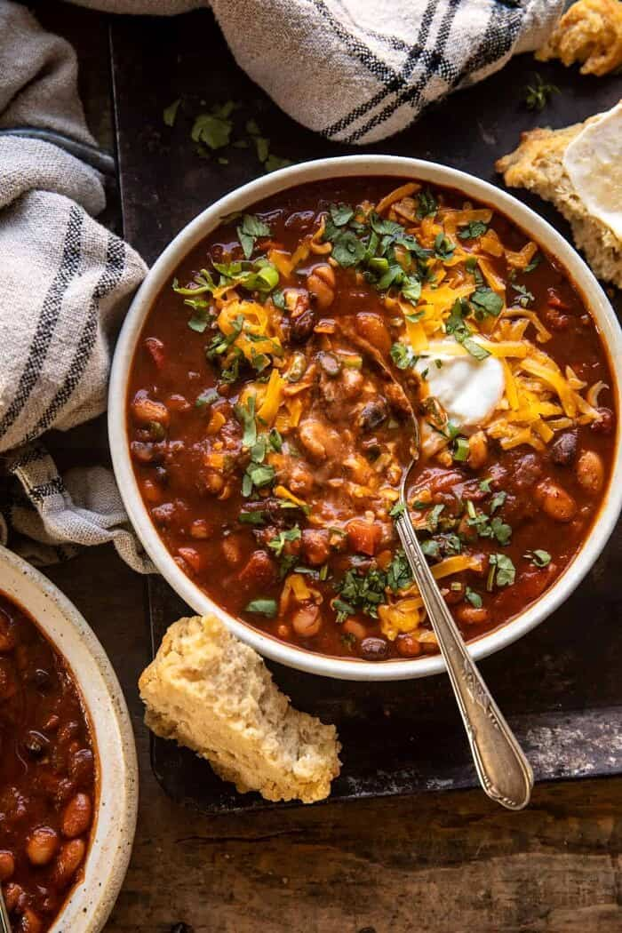 overhead photo of Healthy Slow Cooker Chipotle Bean Chili with spoon in bowl
