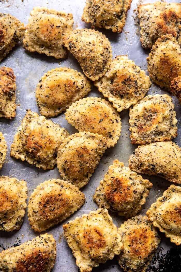 Oven Toasted Garlic Herb Cheese Ravioli on baking sheet after baking