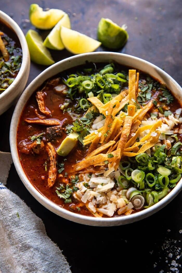 side angled photo of Slow Cooker Chipotle Chicken Tortilla Soup with Salty Lime Chips