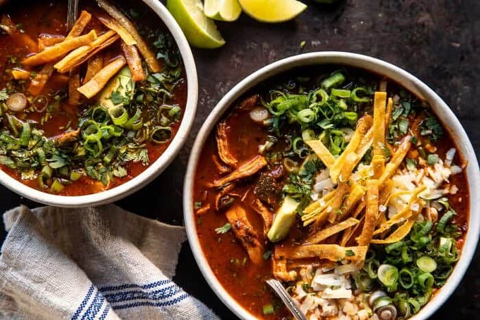 overhead photo of Slow Cooker Chipotle Chicken Tortilla Soup with Salty Lime Chips