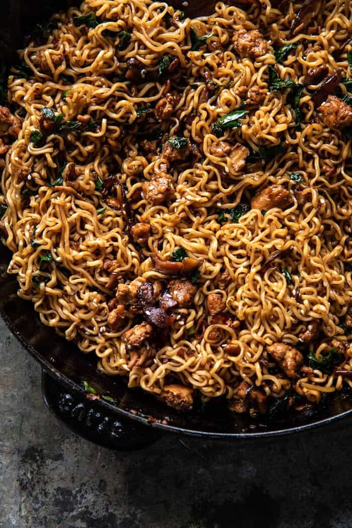 overhead photo of 30 Minute Spicy Sesame Noodles with Ginger Chicken in skillet