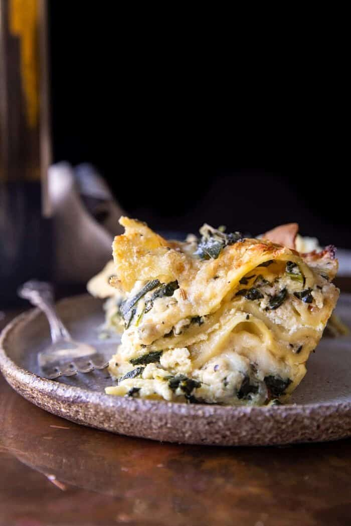 side angled photo of 4 Cheese Sage Pesto Florentine Lasagna | halfbakedharvest.com