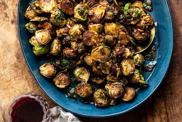 overhead horizontal photo of Fried Brussels Sprouts with Cider Vinaigrette and Bacon Breadcrumbs