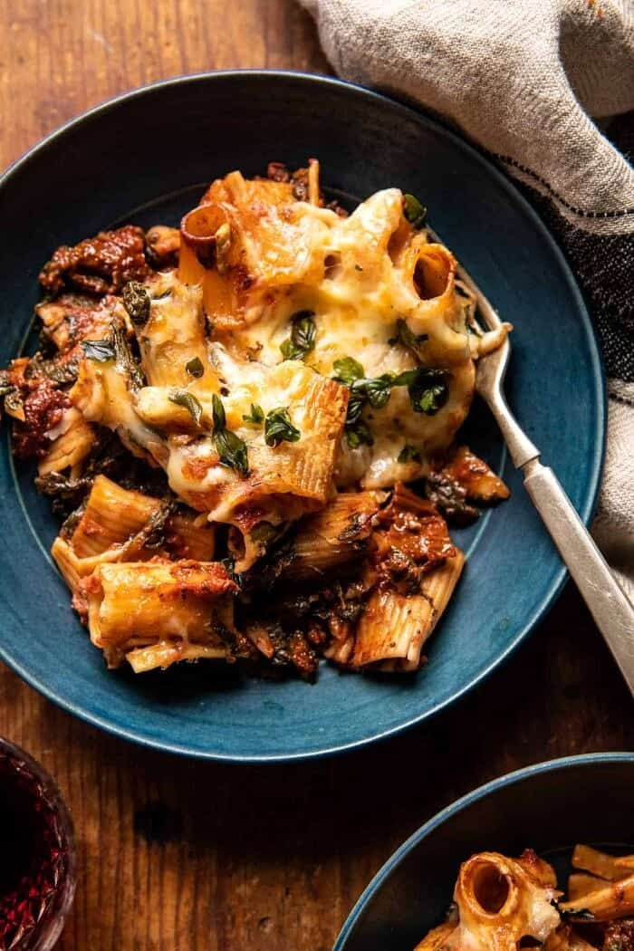 photo of One Pan 4 Cheese Sun-Dried Tomato and Spinach Pasta Bake in serving bowl with fork