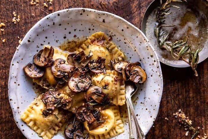 overhead horizontal photo of Rosemary Butter Mushroom and Cheese Ravioli