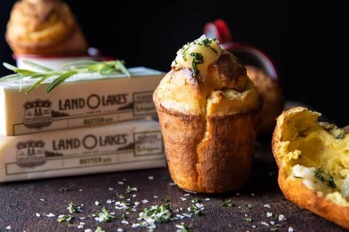 side angled horizontal photo of Salted Rosemary Popovers with Honey Butter | halfbakedharvest.com