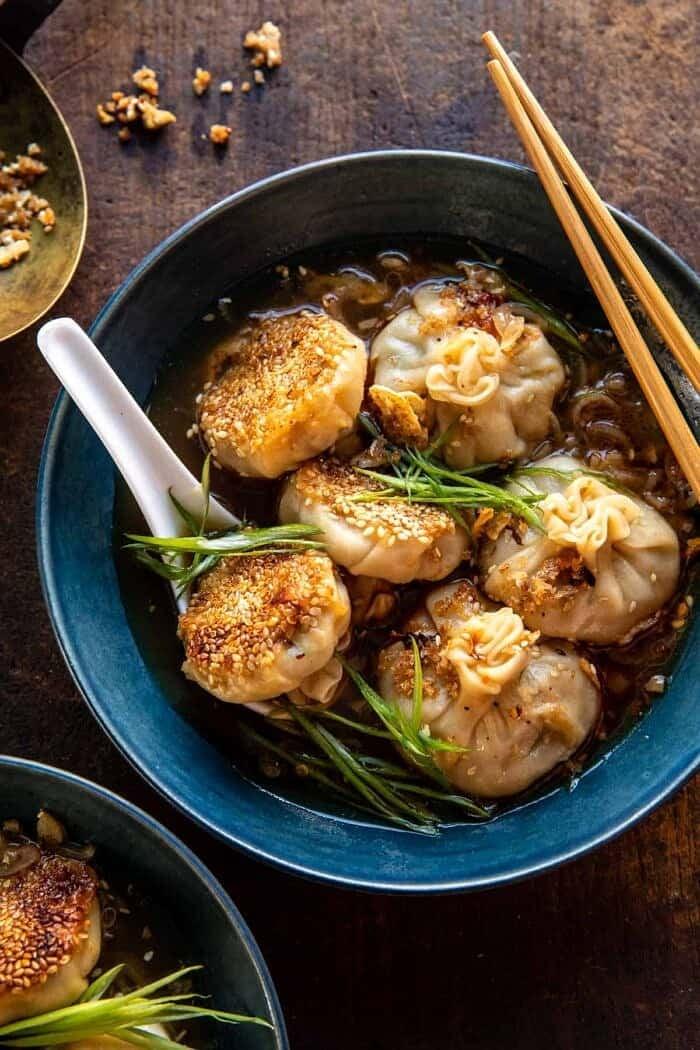 overhead photo of Sesame Chicken Dumplings in Spicy Broth with Garlic Crisps