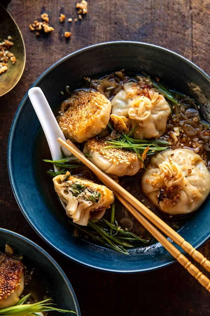 overhead close up photo of Sesame Chicken Dumplings in Spicy Broth with Garlic Crisps