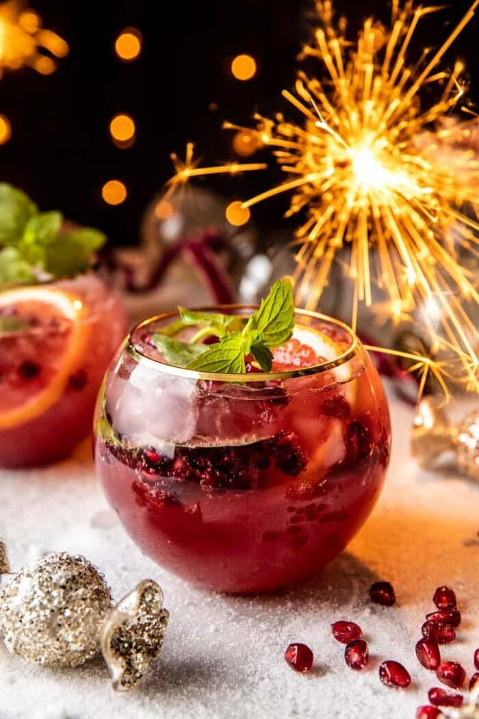 front on photo of Citrus Pomegranate Champagne Twist with sparklers in the background