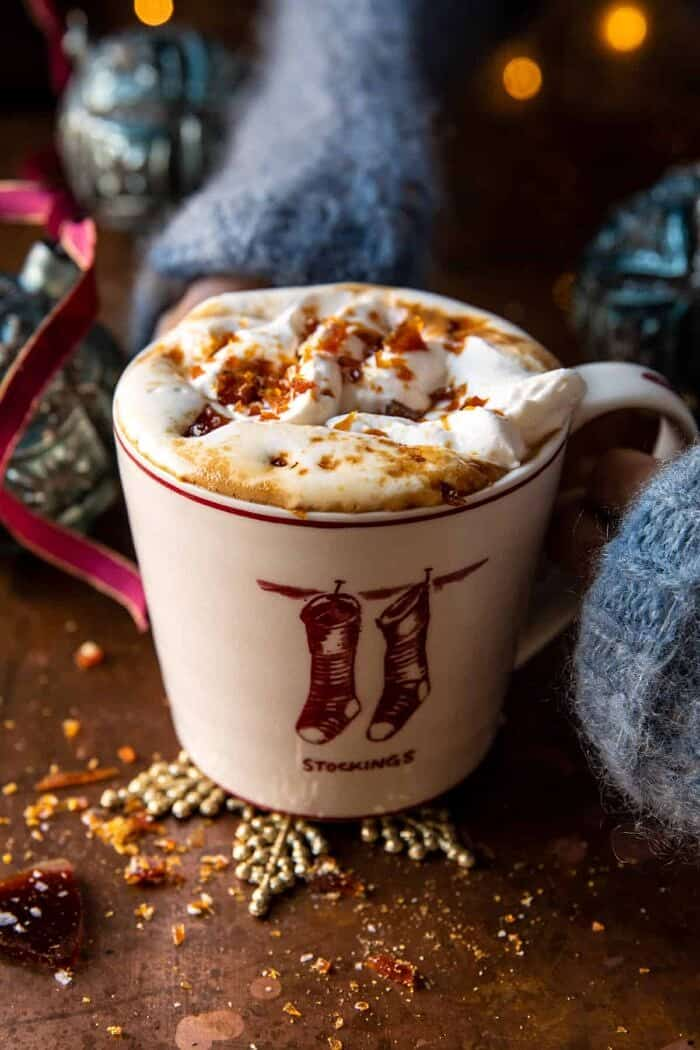 Salted Caramel Brulee Latte with hands on mug