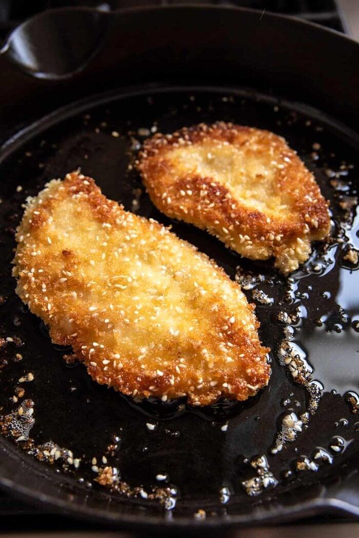 Chicken Katsu cooking in skillet