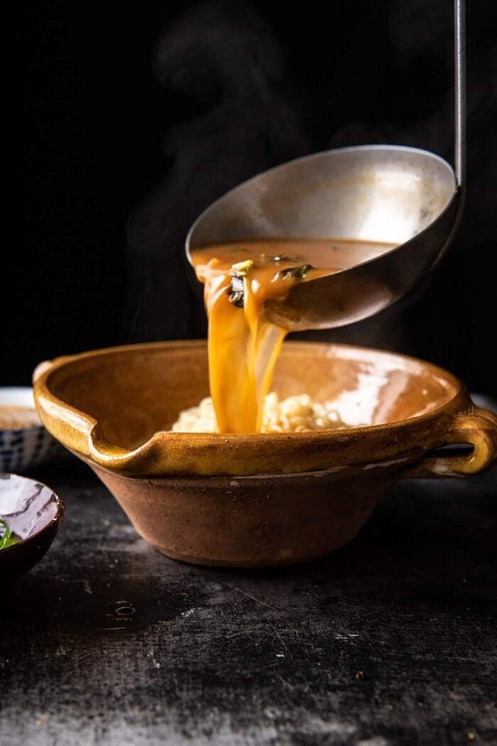 30 Minute Spicy Miso Chicken Katsu Ramen being poured into soup bowl