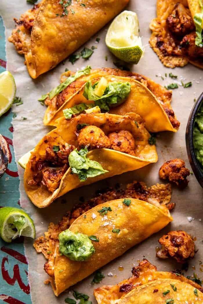 Crispy Cauliflower Tinga Tacos with Honey Lime Avocado Crema.