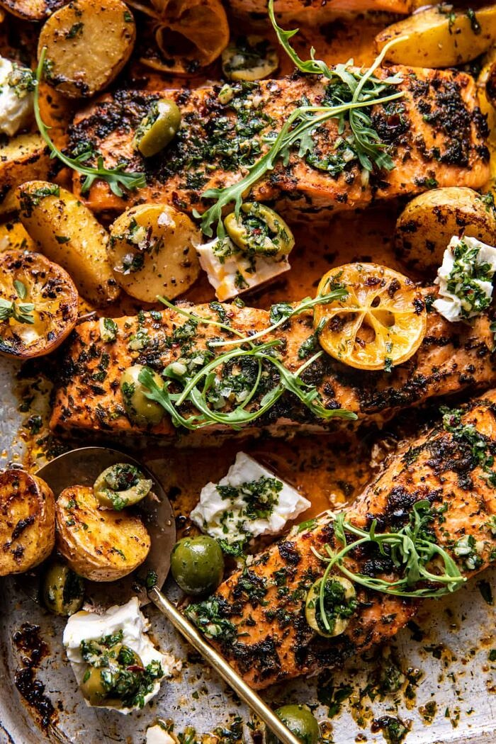 overhead close up photo of Sheet Pan Roasted Lemon Garlic Butter Salmon with Feta and Olives