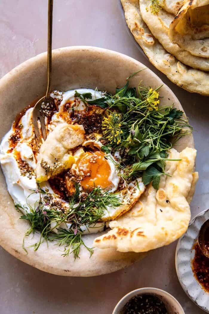 overhead photo of Za'atar Eggs with Lemony Yogurt and Herbs