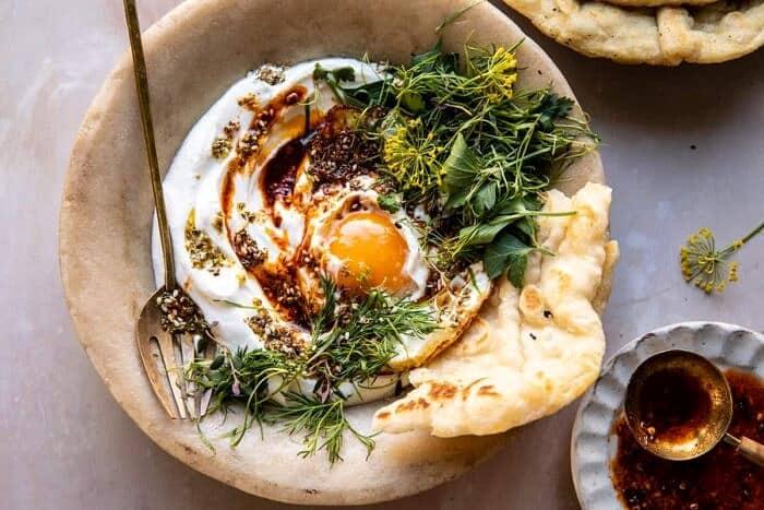 overhead horizontal photo of Za'atar Eggs with Lemony Yogurt and Herbs