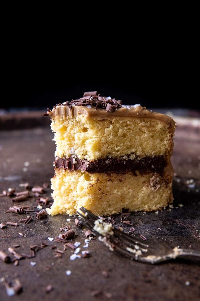 Caramel Butter Cake with Fudgy Chocolate Frosting with bite taken out of cake