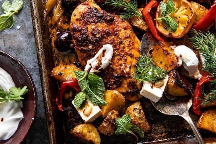 overhead horizontal photo of Easy Greek Sheet Pan Chicken Souvlaki and Potatoes