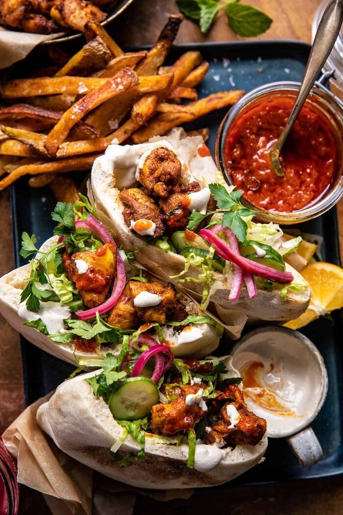 Roasted Turmeric Chicken Pitas with Garlic Lemon Tahini.