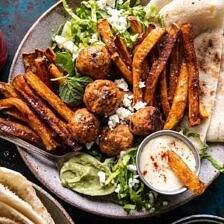 Chicken Meatball Pita Bowls with Seasoned Fries and Feta.