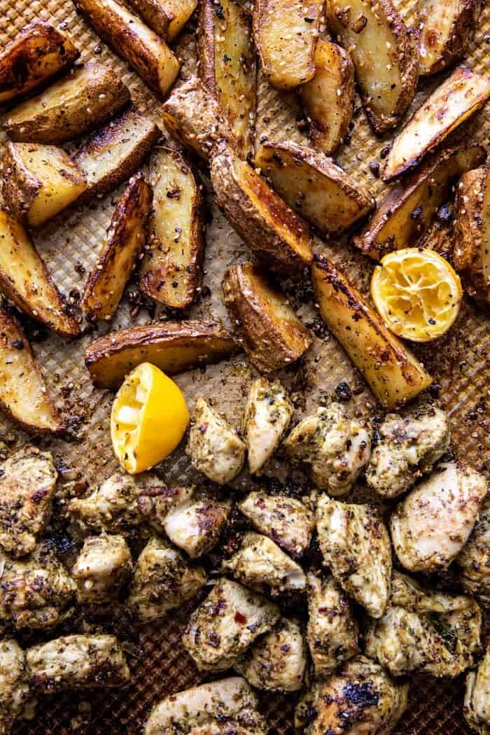 overhead photo of Sheet Pan Pesto Chicken and Lemon Butter Potatoes after baking
