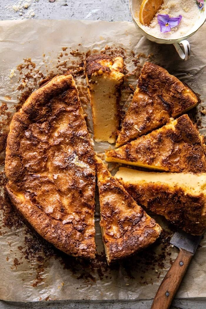overhead photo of Simple Lemon Sugar Burnt Basque Cheesecake with a few slices of cake cut