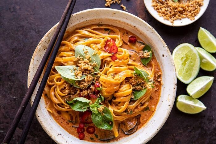 overhead horizontal photo of 20 Minute Red Curry Noodles with Fried Coconut Garlic