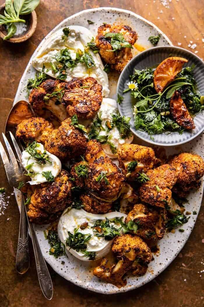 Crispy Roasted Blackened Cauliflower with Burrata and Herbs.
